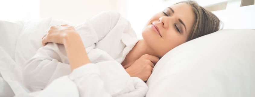 Girl sleeping well after chiropractic care